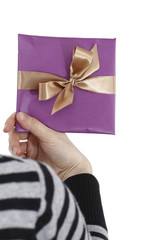 Young woman holding a present