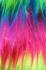 Neon color faux fur background vertical