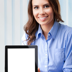 Businesswoman showing blank tablet pc, at office