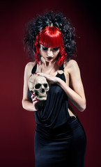 Elegant gothic woman with skull