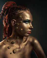 Studio conceptual female bronze beauty portrait