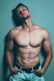 Fototapety Male beauty concept. Portrait of  handsome muscular male model i
