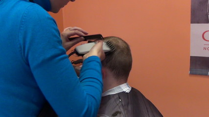 Zoom out customer man head and hairdresser make hair dress