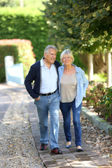 Senior couple walking together in park