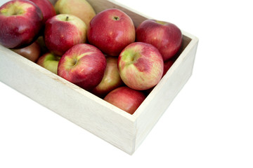 Apples in the wooden box on the table, close up