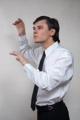 Handsome man in white shirt. Studio white background.