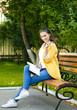 Beautiful young woman in yellow coat
