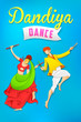 Man and woman playing dandiya dancing Garba