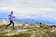 Trail running woman in cross country run