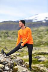 Runner man stretching legs after running trail run