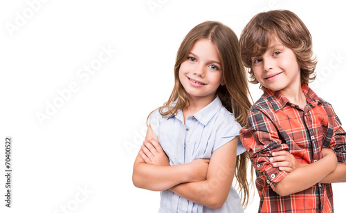 Kids posing over white poster