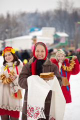 Women with pancakes during  Shrovetide