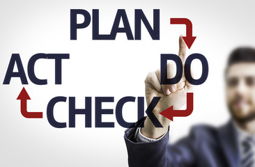 Business man pointing the text: Plan Do Check Act