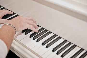 Hands playing antique German piano