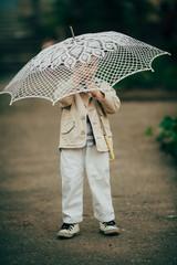 child boy with lace umbrella