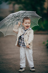 child boy with lace umbrella