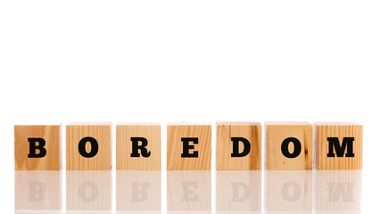 The word - Boredom- on wooden cubes