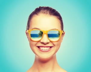 happy teenage girl in sunglasses