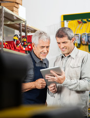 Salesperson And Customer Using Digital Tablet