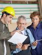 Carpenters Discussing Over Document