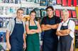 Leinwanddruck Bild - Confident Salespeople In Hardware Shop