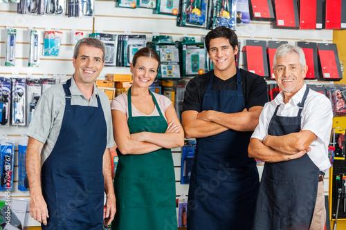 Leinwanddruck Bild Confident Salespeople In Hardware Shop