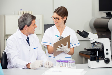 Scientist Working With Colleague In Medical Lab