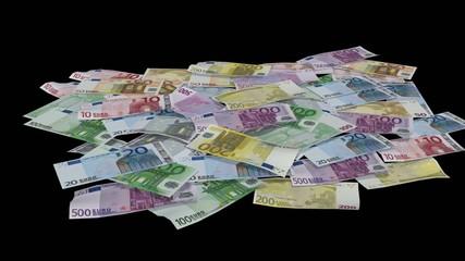 many Euro bills on black background