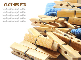 Wooden clothes pin and laundered denim fabric isolated on white
