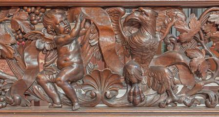 Bruges - relief of evangelist st. Matthew and st. John symbols