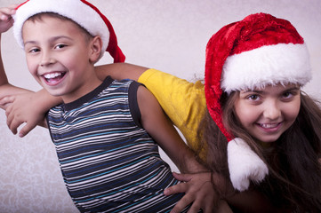 happy children with Santa Claus red hats