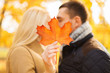 close up of couple kissing in autumn park