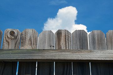close up of wooden fence against sky