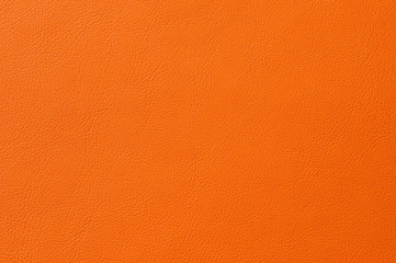 Closeup of seamless orange leather texture