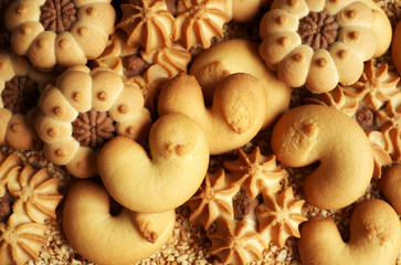 Assorted cookies on chopped hazelnuts, selective focus