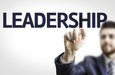 Business man pointing to transparent board with text: Leadership