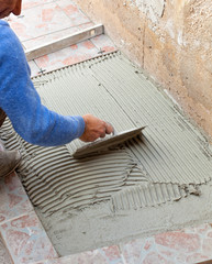 Tiler works with flooring.