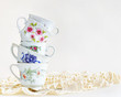 Stack of vintage tea cups on white - 70408949