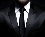 Man gentleman in black suit and tie poster