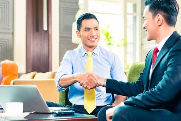 Asian Businessmen having meeting