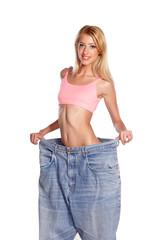 skinny beautiful blonde dressed in her old big pants