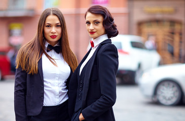 beautiful girls in black suits