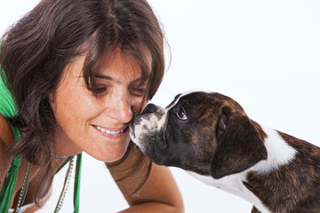 Boxer dog kissing a woman