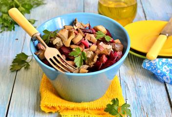 Beetroot salad with mushrooms.