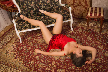 Sensual woman in a luxurious lingerie lying on the floor