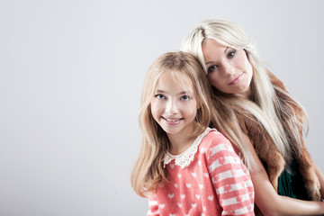 Mother with daughter in studio