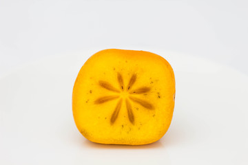 slice persimmon on white background