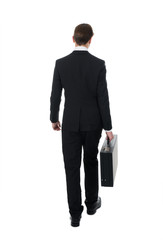Rear View Of Businessman Carrying Briefcase