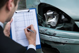 Fototapety Insurance Agent Examining Car After Accident