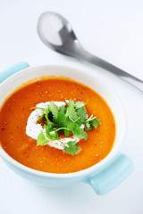 Sweet potato red peppers soup on white background